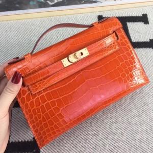 Hermes Orange Kelly Pochette Shiny Niloticus Crocodile Bag